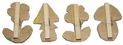 Приклеивание прищепок к картонным декоративным элементам